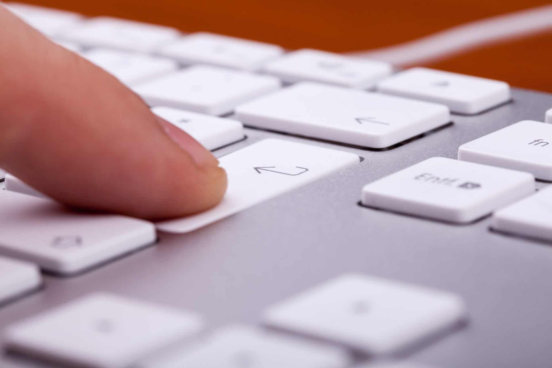 Finger pressing on keyboard