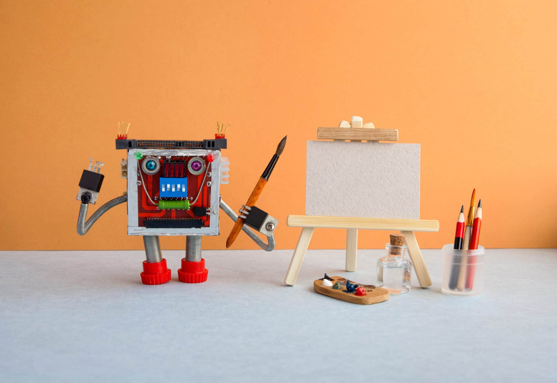 little robot with a canvas